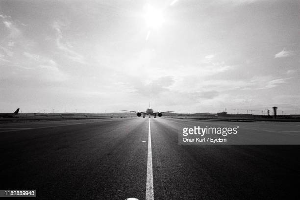 airplane on runway against sky - istanbul stock pictures, royalty-free photos & images