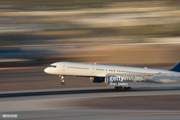 Airplane on Runway in Motion