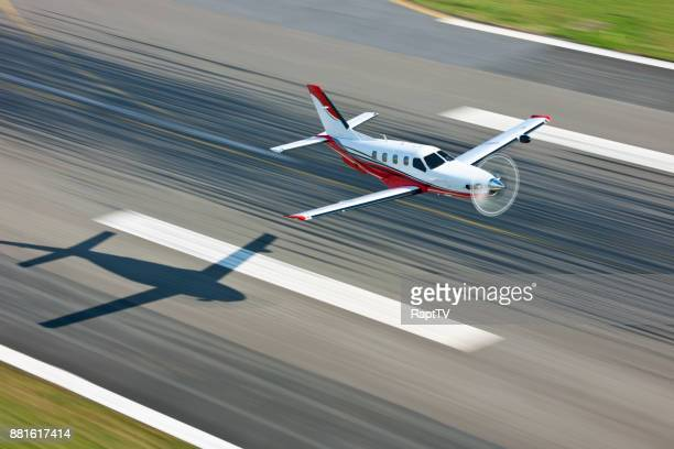 Airplane over Runway with shadow and motion blur.
