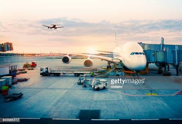 airplane parked at paris international airport - aircraft stock photos and pictures