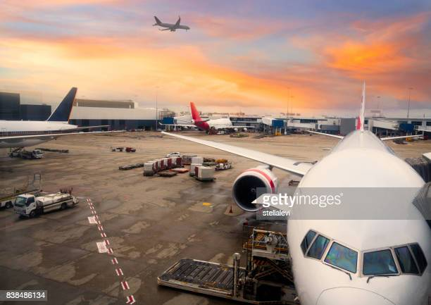 airplane parked at sydney international airport - built structure stock pictures, royalty-free photos & images