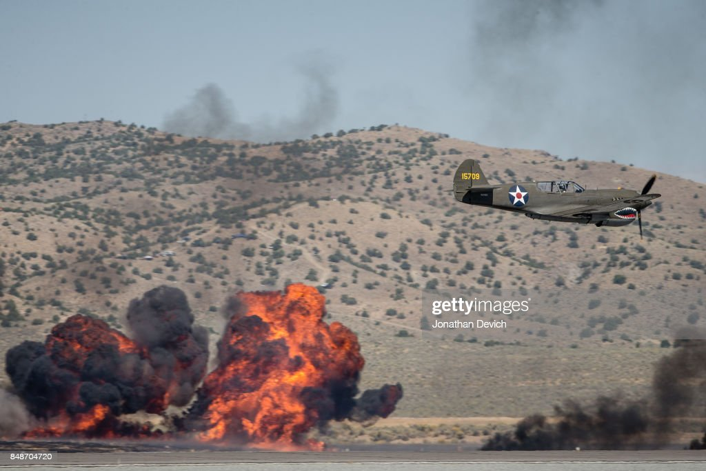 A P-40E airplane participates in a battle reenactment show at the Reno Championship Air Races on September 17, 2017 in Reno, Nevada.
