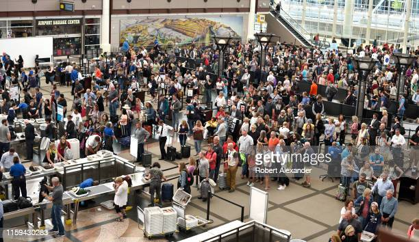 Airplane passengers line up for TSA security screenings at Denver International Airport in Denver, Colorado.