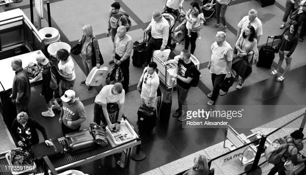 Airplane passengers line up for TSA security screenings at Denver International Airport in Denver, Colorado.