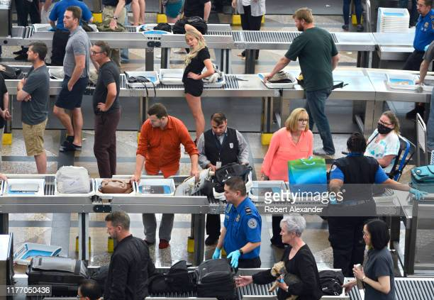 Airplane passengers proceed through the TSA security checkpoint at Denver International Airport in Denver Colorado