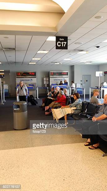 Airplane passengers waiting Houston, Texas airport for United Airlines flight.
