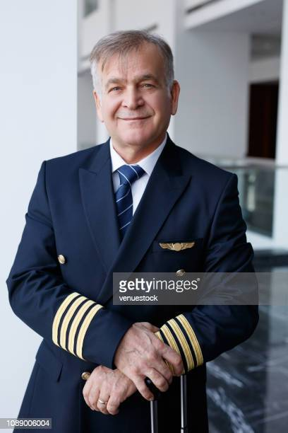 airplane pilot looking at camera and smiling - piloting stock pictures, royalty-free photos & images