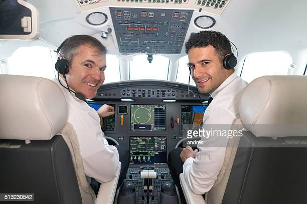 Airplane pilots in the cockpit looking happy