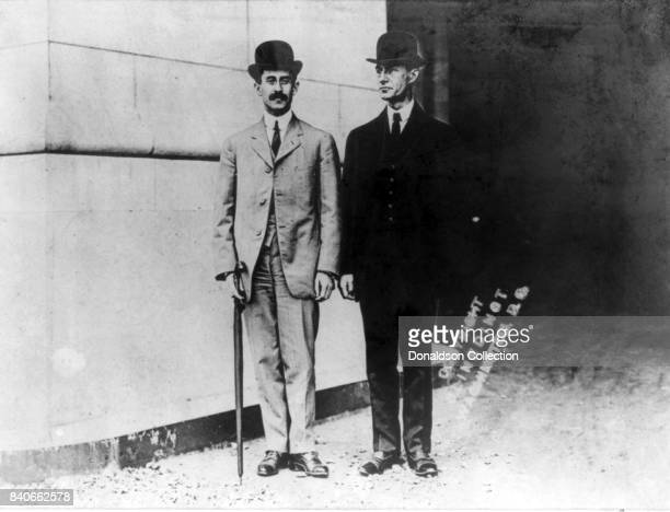 Airplane pioneers Wilbur Wright and Orville Wright pose for a portrait in circa 1910