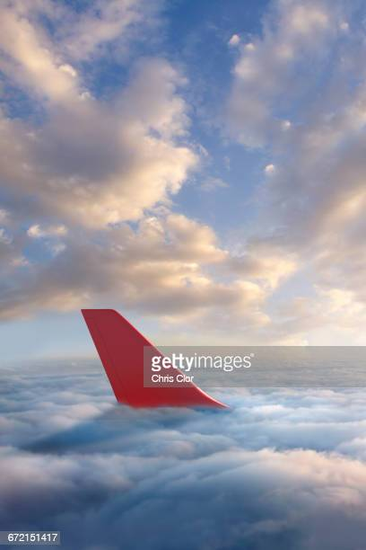 airplane rudder above clouds - airplane tail stock pictures, royalty-free photos & images