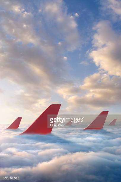 Airplane rudders above clouds