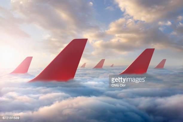 airplane rudders above clouds - vertical stabilizer stock pictures, royalty-free photos & images