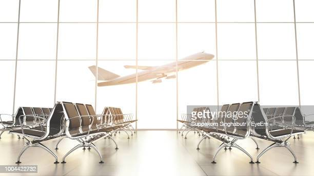 airplane seen through glass window at airport - gate stock pictures, royalty-free photos & images