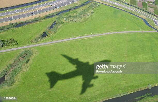 airplane shadow - shadow stock pictures, royalty-free photos & images