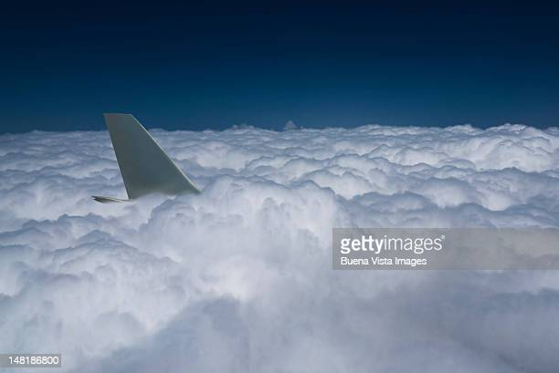 airplane tail  in a sea of clouds