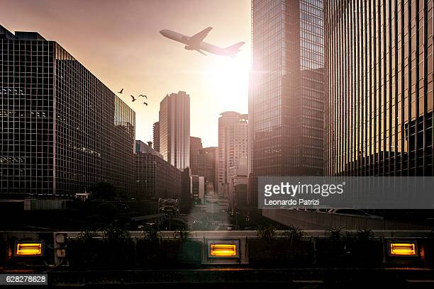 Airplane taking of in Osaka-Japan city downtown