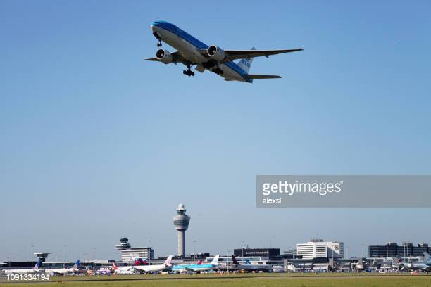 airplane taking off airport schiphol amsterdam, netherlands - schiphol airport stock photos and pictures