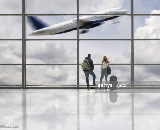 airplane taking off in airport terminal - arrival stock pictures, royalty-free photos & images