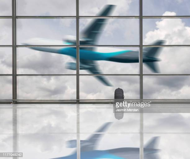 airplane taking off in airport terminal - international match stock pictures, royalty-free photos & images