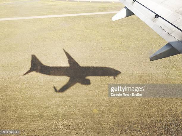 airplane taking off - airfield stock pictures, royalty-free photos & images
