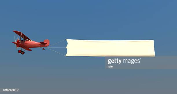 airplane towing a banner - bericht stockfoto's en -beelden