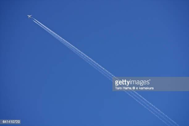 Airplane vapor trail in blue sky