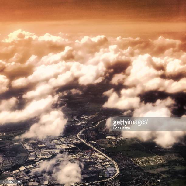 airplane view of city - rob castro stock pictures, royalty-free photos & images