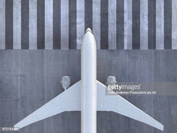 airplane viewed from directly above - arrival photos stock photos and pictures