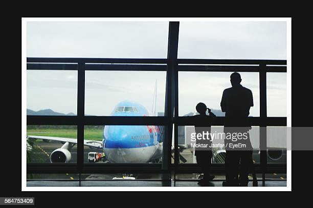 airplane viewed through airport - kid in airport stock pictures, royalty-free photos & images