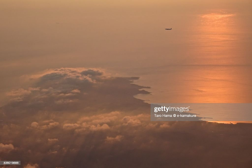 Airplane waiting for landing in the air due to thunder storm sunset time aerial view from airplane : ストックフォト
