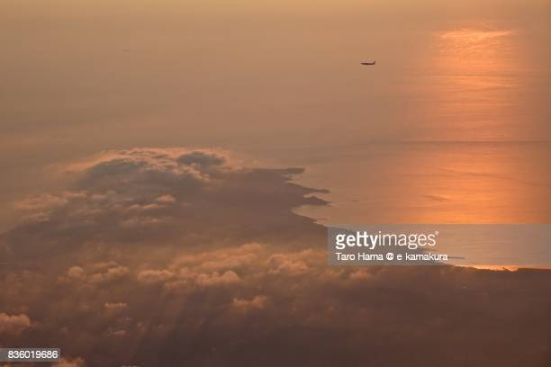 Airplane waiting for landing in the air due to thunder storm sunset time aerial view from airplane