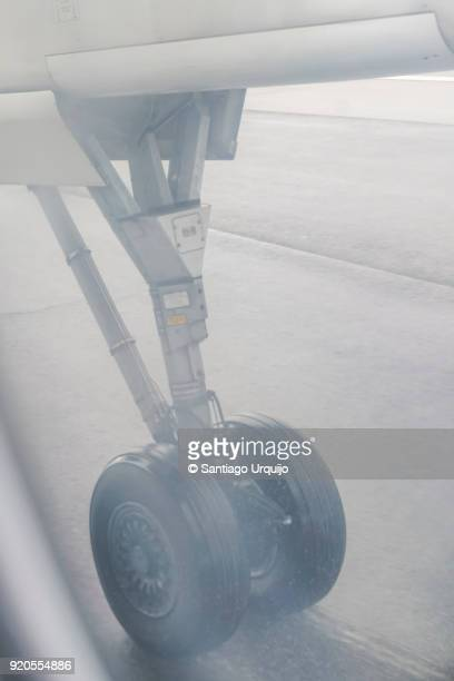 Airplane wheels on runway while landing