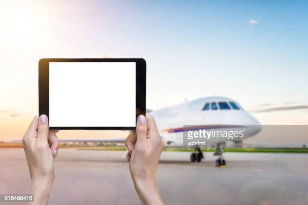 Airplane & white screen tablet