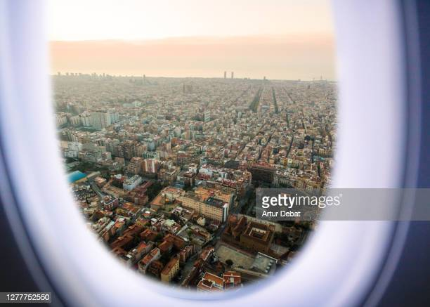 airplane window view from passenger point of view of the barcelona cityscape. - cityscape stock pictures, royalty-free photos & images