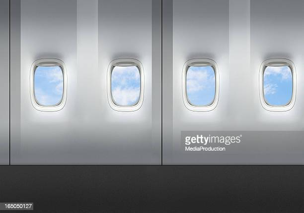 airplane windows - vehicle interior stock pictures, royalty-free photos & images