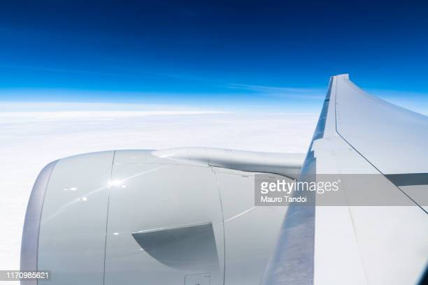 airplane wing against clear blue sky - mauro tandoi stock photos and pictures