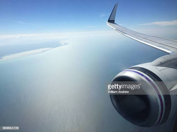 Airplane wing and engine, horizon in background