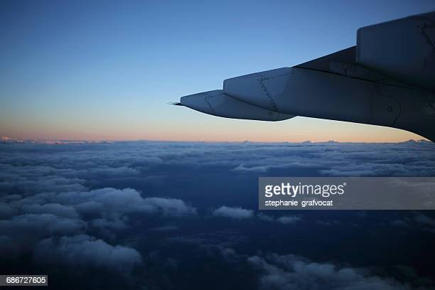 Airplane wing flying in the sky