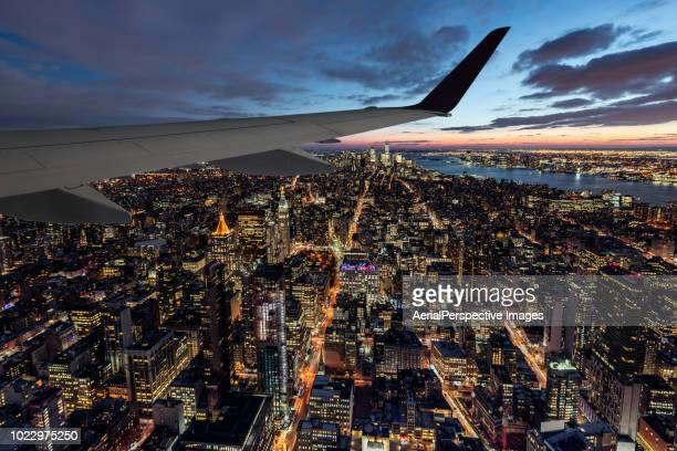 Airplane Wing over New York City at Dusk