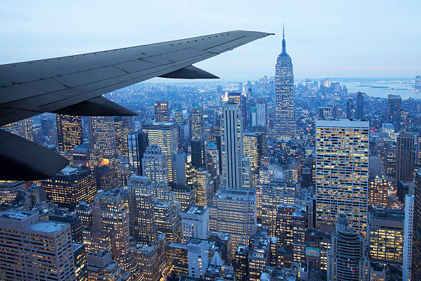 Airplane Wing Over New York Wall Art
