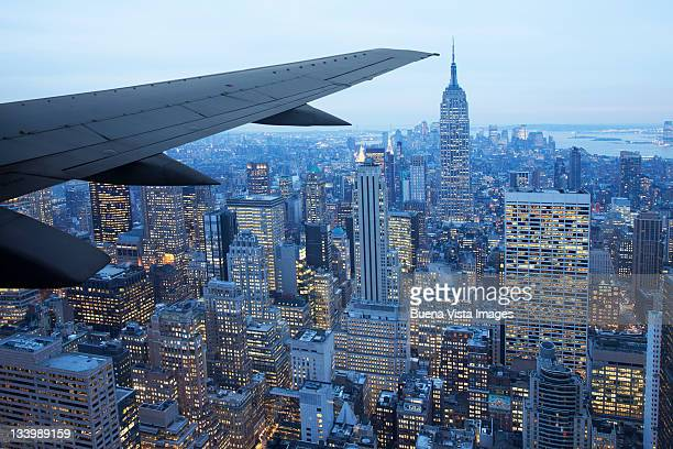 Airplane wing over New York