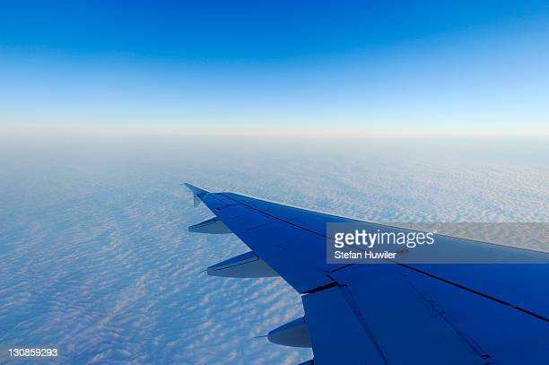 Airplane wings over a sea of fog, Basel, Switzerland, Europe