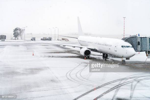 airplane & winter travel - snow storm stock photos and pictures