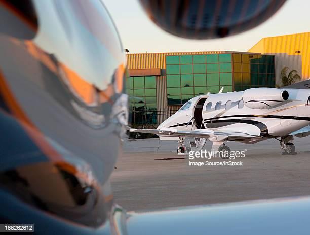 Airplane with open door on runway