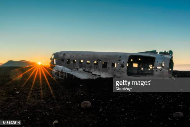 airplane wreck at sunrise - solheimasandur iceland - fuselage stock photos and pictures