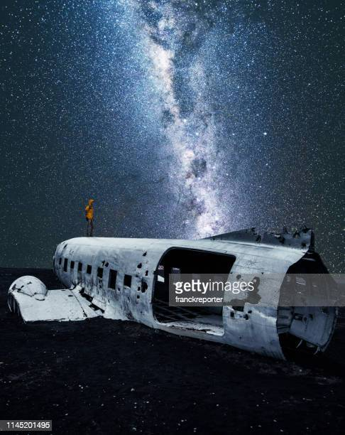 airplane wreck in iceland under the stars - crash site stock pictures, royalty-free photos & images