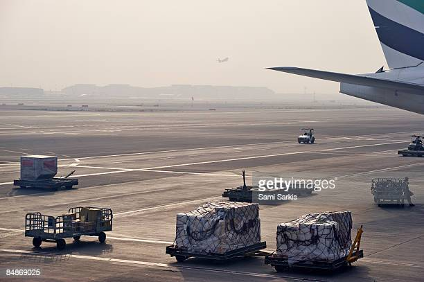 Airplanes and carriages on tarmac