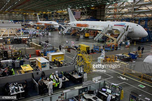 787 airplanes are manufactured at the Boeing Co facility in Everett Washington US on Monday June 1 2015 Flow a measure of the time needed to put...