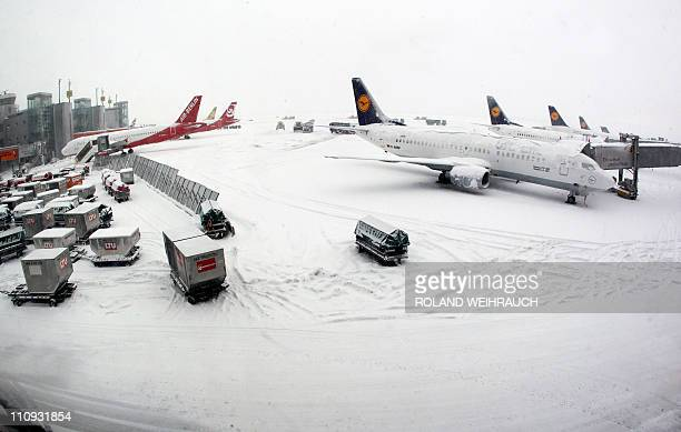 Airplanes are parked at the airport in the western German city of Duesseldorf on December 24 2010 Wintery weather conditions continue to make...