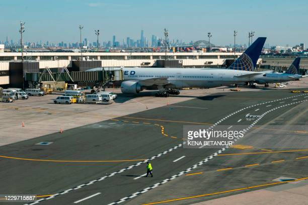 Airplanes are parked at their gates at Newark International Airport on November 21, 2020 in Newark, New Jersey. - Current US numbers -- more than a...